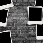 Blank Photos on Dark Brick Background — Stock Photo