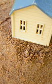 Toy House on Sand — Stock Photo