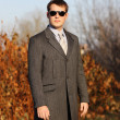 Min grey coat — Stock Photo #2753972