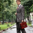 Stock Photo: Businessman walking on the street