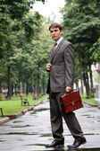 Businessman walking on the street — Stock Photo