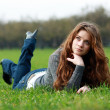 Girl on green grass — Stok fotoğraf