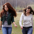 Two cheerful girls in the spring park — Stock Photo