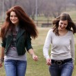 Two cheerful girls in the spring park — Stock Photo #2869464