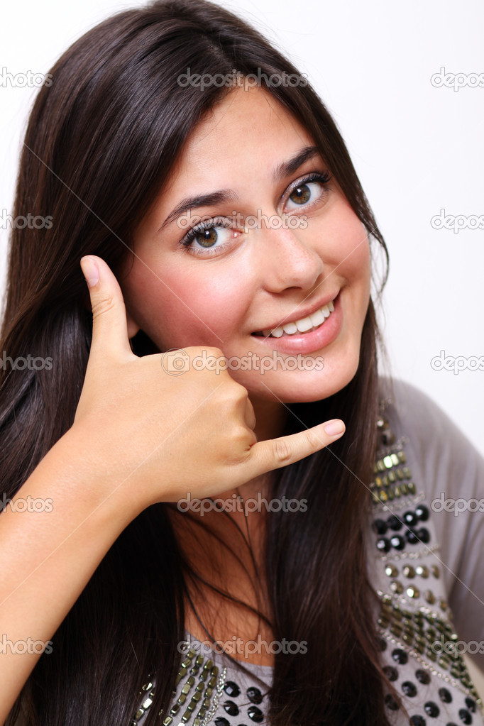 Picture of lovely woman making a call me gesture — Stock Photo #2869491