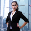 Business of the lady against skyscrapers — Stock Photo #2981144
