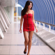 Walking woman in red dress - Stock Photo