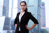 Business of the lady against skyscrapers — Stock Photo