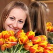 Stock Photo: Portrait of beautiful girl with tulips