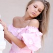 Portrait of young woman in pink dress — Stock Photo