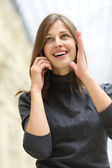 Woman with mobile telephone — Stock Photo