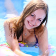 Woman in swimming pool - Stock Photo