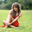 Woman rest on grass field at the park - Stock Photo