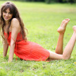 Woman rest on grass field at the park — Stock fotografie