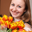 Blonde holding bunch of flowers — Stock Photo #3612094