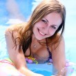 Happy woman in swimming pool - Stock Photo