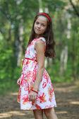 Beautiful little girl at the park — Stockfoto