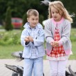 Children playing with doves - Stock Photo