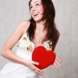 Woman holding a red heart — Stock Photo #3740825