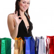 Portrait of one happy young adult girl with colored bags - Foto de Stock