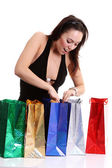 šťastná dívka dospělých s barevné tašky — Stock fotografie