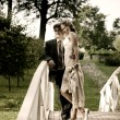 Stock Photo: Wedding couple on a bridge
