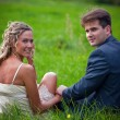 Wedding couple on grass — Stock Photo