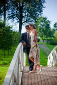 Wedding couple on a bridge — Stock Photo