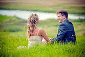 Wedding couple on grass — Stock Photo