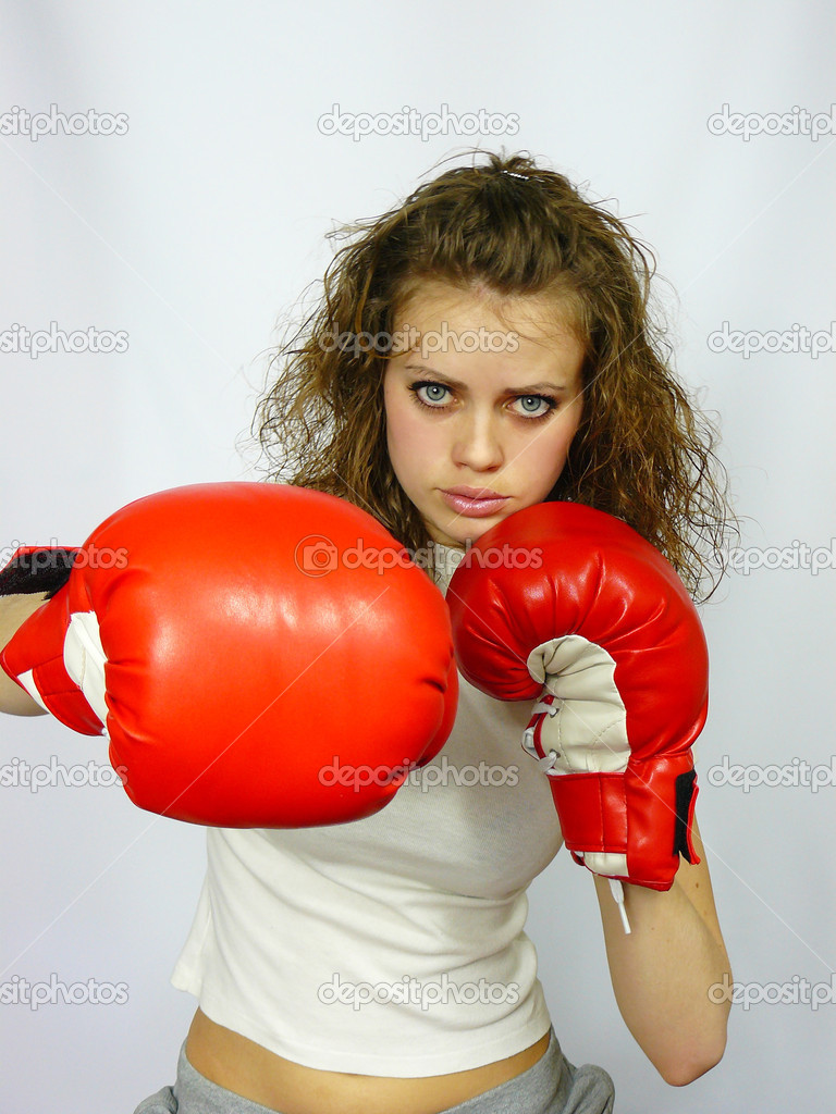 Young nice sportswoman in boxing gloves on a white background — Stock Photo #2813553