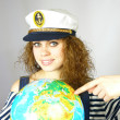 Attractive woman and the globe — Stock Photo