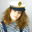 Stock Photo: Young girl in a captain's cap