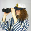 Stock Photo: Young girl in captain's cap