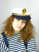 Young girl in a captain's cap — Stock Photo
