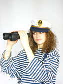 Young sailor girl with binoculars — Stock Photo