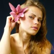 Woman with a lily in hairs — Stock Photo #3397936