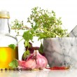 Olive oil and mortar with spicery - Stockfoto