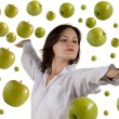 Royalty-Free Stock Photo: Girl and flying apple