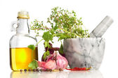 Olive oil and mortar with spicery — Stock Photo