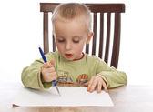 Boy writing — Stock Photo
