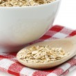 Oat flakes and spoon — Stock Photo