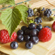 Bilberries,blackberry and raspberries, summer fruits - Stock Photo