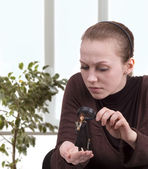 Competitor under magnifying glass — Stock Photo