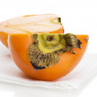 Persimmon on placemat isolated - ストック写真