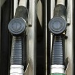 Fuel pump nozzles - Stock Photo