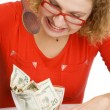 Girl eating money — Stock Photo