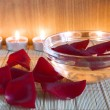 Candle and rose petal — Stock Photo
