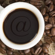 Stock Photo: Coffee beans and cap of coffee