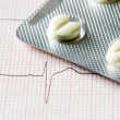Tablet and cardiogram — Stock Photo