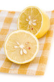 Lemon on placemat isolated — Stock Photo